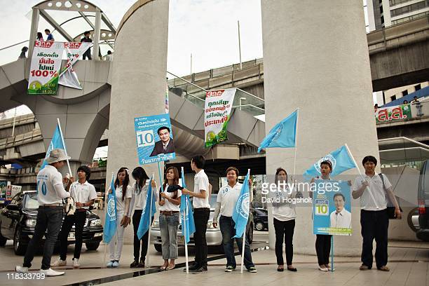 Supporters of Abhisit Vejjajiva Prime Minister and leader of the Democrats attend a small final rally outside Bangkok Art and Culture Center near the...