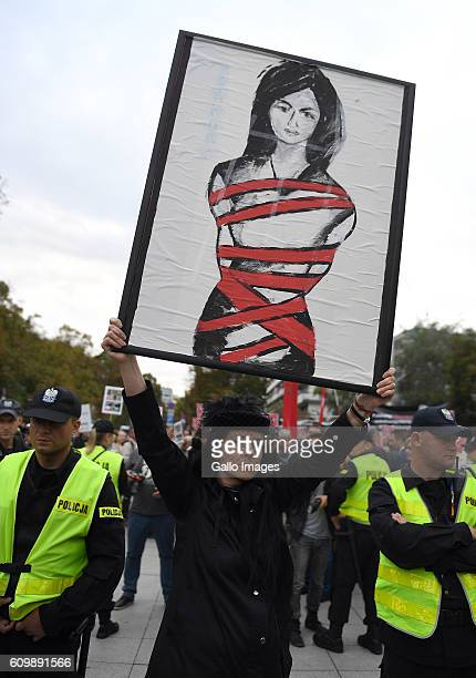 Supporters of abortion participate in the black protest on September 22 2016 in Warsaw Poland The action is organized to express the opposition to...