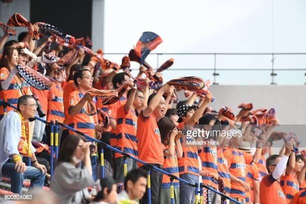 Supporters of AC Nagano Parceiro wave mufflers during the JLeague J3 match between Giravanz Kitakyushu and AC Nagano Parceiro at Mikuni World Stadium...