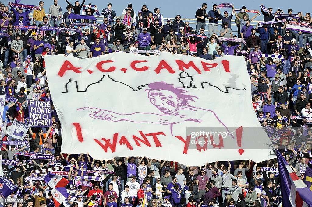 Supporters of ACF Fiorentina hold up a large banner during the Serie A match between ACF Fiorentina and AC Chievo Verona at Stadio Artemio Franchi on March 3, 2013 in Florence, Italy.