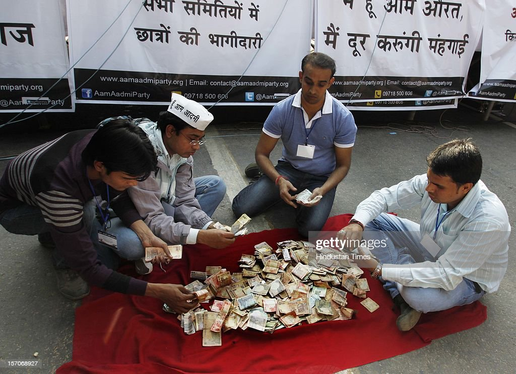 Supporters of activist turned politician Arvind Kejriwal collecting money for donation during the launch of the 'Aam Aadmi Party' on November 26, 2012 in New Delhi, India.