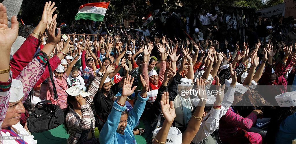 Supporters of activist turned politician Arvind Kejriwal listen to his speech during the launch of the 'Aam Aadmi Party' on November 26, 2012 in New Delhi, India.