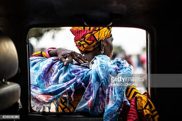 A supporters of Adama Barrow the flagbearer of the coalition of the seven opposition political parties in Gambia leans on the door of a car in the...