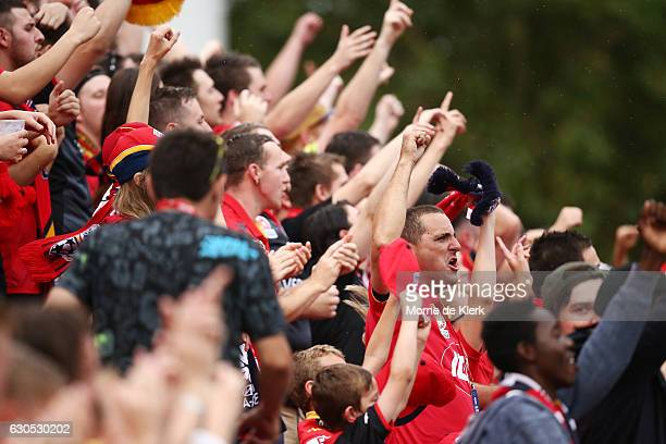 Supporters of Adelaide United cheer during the round 12 ALeague match between Adelaide United and Sydney FC at Coopers Stadium on December 26 2016 in...
