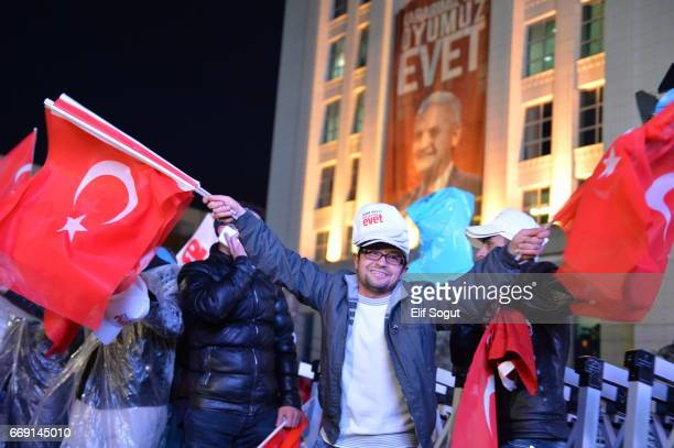 Supporters of AK party react at the party headquarters in Ankara April 16 2017 Turkey Millions of Turks are heading to the polls to vote on a set of...
