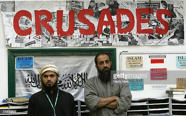 Supporters of Al Muhajiroun a radical Islamic group look on during a conference September 11 2003 in London Al Muhajiroun who have previously...