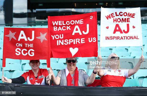 Supporters of Alex Johnson of the Swans hold banners during the round 15 NEAFL match between the Sydney Swans and the Gold Coast Suns at Sydney...