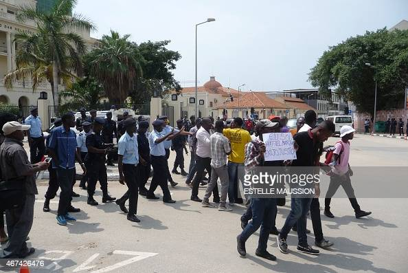 Supporters of an Angolan anticorruption activist are dispersed by Angolan police officers at the end of the first day of his trial on March 24 2015...
