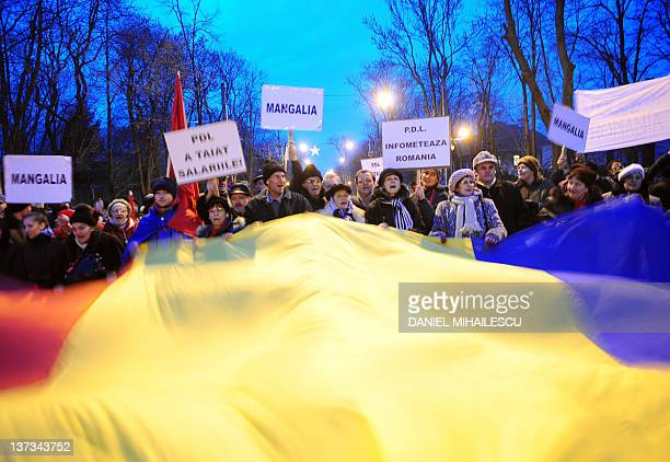 Supporters of an opposition coalition the Liberal Social Union National Liberal Party and Social Democrat Party hold a giant Romanian flag and shout...