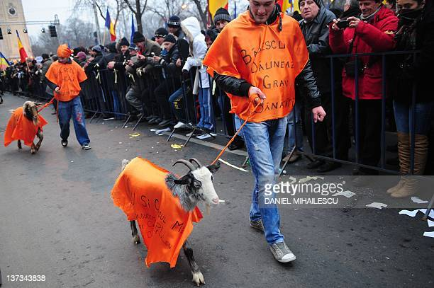 Supporters of an opposition coalition the Liberal Social Union National Liberal Party and Social Democrat Party wearing orange bibs reading 'Basescu...