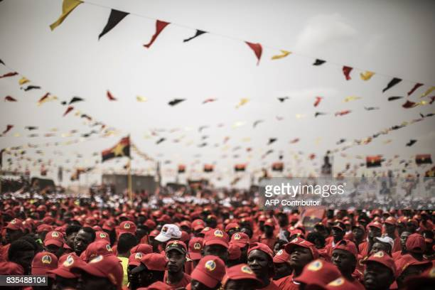 Supporters of Angolan President and The People's Movement for the Liberation of Angola President Jose Eduardo dos Santos and MPLA presidential...
