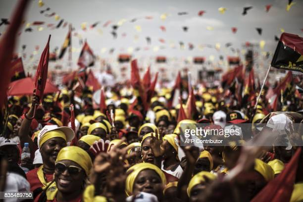 TOPSHOT Supporters of Angolan President and The People's Movement for the Liberation of Angola President Jose Eduardo dos Santos and MPLA...