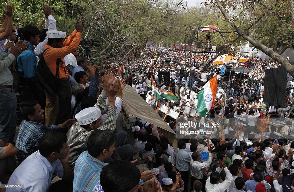 Supporters of anti-corruption activist <a gi-track='captionPersonalityLinkClicked' href=/galleries/search?phrase=Anna+Hazare&family=editorial&specificpeople=5963003 ng-click='$event.stopPropagation()'>Anna Hazare</a> gather during his day-long fast at at Jantar Mantar on March 25, 2012 in New Delhi, India. Team Anna members Manish Shisodia (L) and Kumar Vishwas (R) also seen in the picture. The fast was organized to press for a strong law to protect whistleblowers.