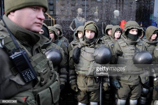 Supporters of anticorruption activist Mikheil Saakashvili block the entrance to a court where his pretrial is being held in Kiev Ukraine on December...