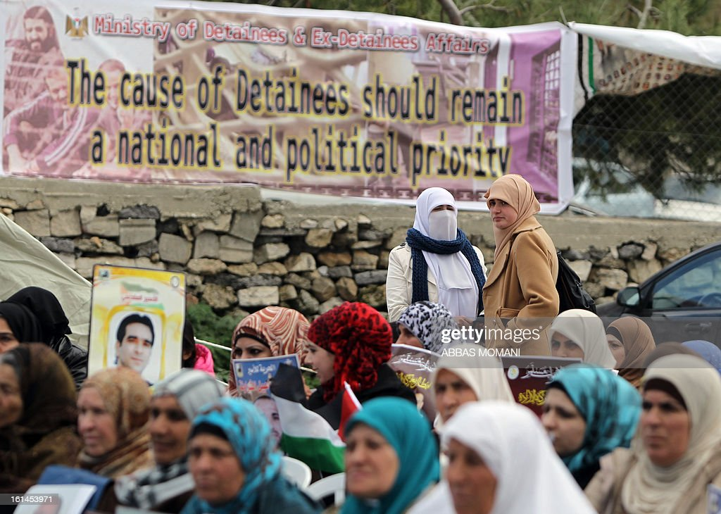 Supporters of Arab-Israeli Islamist leader Sheikh Raed Salah attend a demonstration in support with Palestinian prisoners held in Israeli jails, some of whom are observing a hunger strike, in the West Bank city of Ramallah on February 11, 2013.