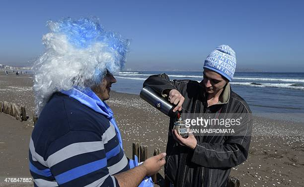 Supporters of Argentina drink mate at the beach in La Serena Coquimbo Chile on June 12 2015 on the eve of the 2015 Copa America group B football...