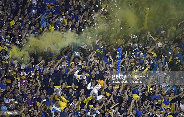 Supporters of Argentina's Boca Juniors cheer for their team during the Copa Libertadores 2013 football match against Brazil's Corinthians at 'La...