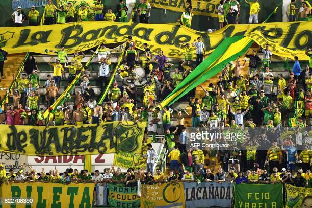 Supporters of Argentina's Defensa y Justicia cheer for their team during their 2017 Copa Sudamericana football match against Brazils Chapecoense held...
