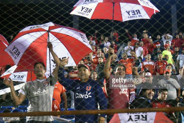 Supporters of Argentina's Independiente football team cheer before the start of the Copa Sudamericana first leg semifinal football match against...
