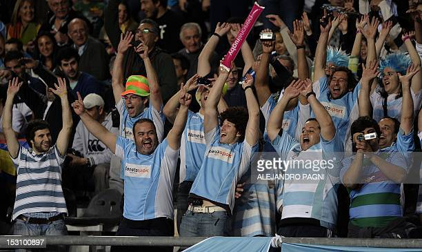 Supporters of Argentina's Los Pumas cheer their team during the Rugby Championship fifth round match against New Zealand's All Blacks at La Plata...