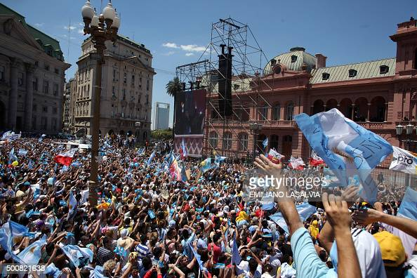 Supporters of Argentine new President Mauricio Macri gather outside the Casa Rosada in Buenos Aires on December 10 2015 Macri's inauguration marks...