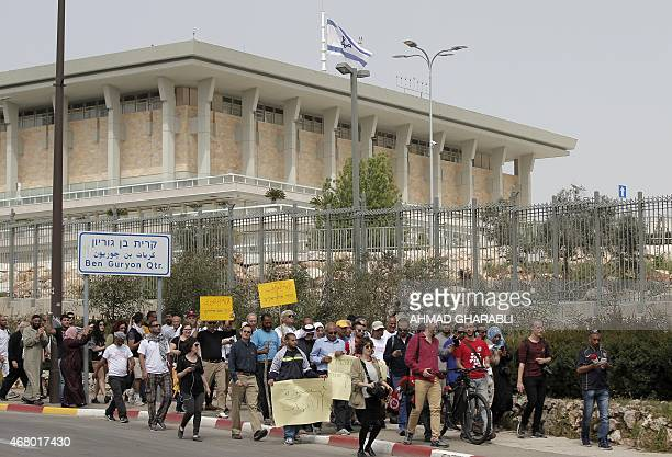 Supporters of Ayman Odeh the head of Israel's Arab parliamentary bloc walk past the Knesset the Israeli parliament as they arrive in Jerusalem on...