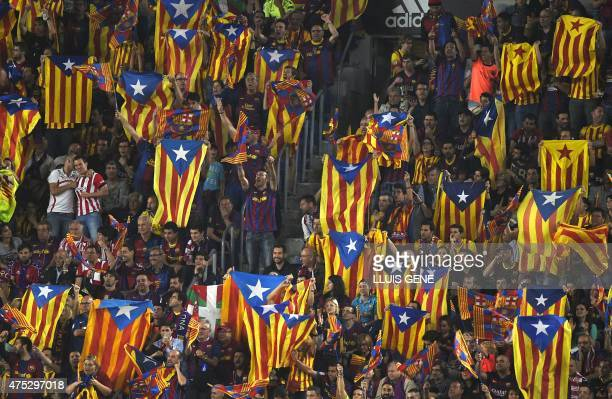 Supporters of Barcelona wave Catalan independentist flags 'Estelada' as one also displays a Basque flag prior to the Spanish Copa del Rey final...
