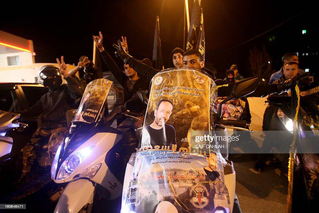 Supporters of Bassam Saadi, leader of the West Bank Islamic Jihad movement celebrate after his release from an Israeli jailat the Jenin refugee camp in the West Bank, on February 4, 2013. AFP PHOTO/SAIF DAHLAH