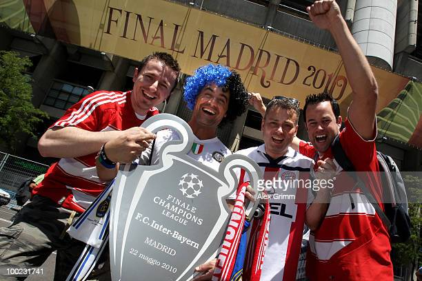 Supporters of Bayern Muenchen and Inter Milan celebrate before the UEFA Champions League final of their teams at Santiago Bernabeu stadium on May 21...