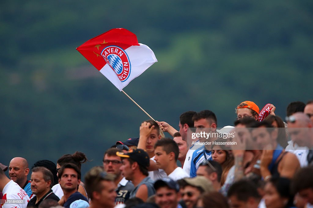 Supporters of Bayern Muenchen wave a flag during the friendly match between Brescia Calcio and FC Bayern Muenchen at Campo Sportivo on July 9 2013 in...