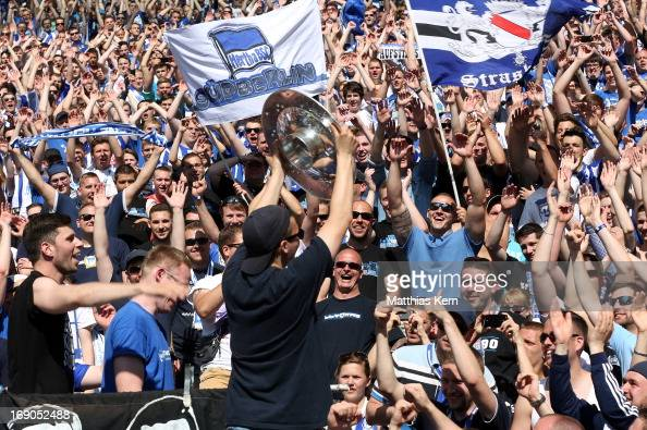 http://media.gettyimages.com/photos/supporters-of-berlin-celebrate-with-the-cup-after-their-team-winning-picture-id169052488?s=594x594