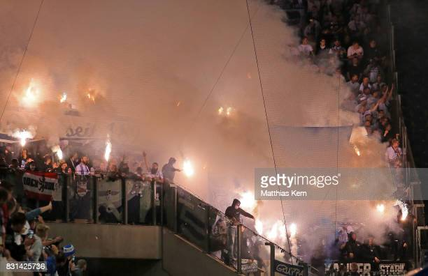 Supporters of Berlin use pyrotechnical articles during the DFB Cup first round match between FC Hansa Rostock and Hertha BSC at Ostseestadion on...