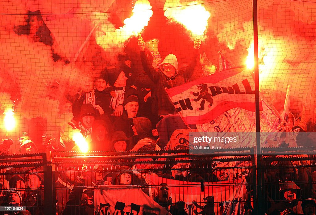 Supporters of Berlin with pyrotechnical articles celebrate their team during the Second Bundesliga match between FC Energie Cottbus and Hertha BSC Berlin at Stadion der Freundschaft on December 3, 2012 in Cottbus, Germany.