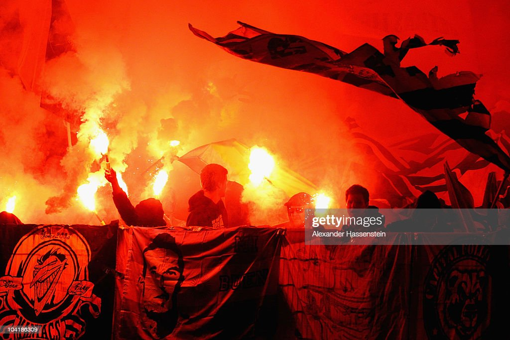 Supporters of Bern burn bengalese fires during the UEFA Europa League group H match between VfB Stuttgart and BSC Young Boys Bern at...