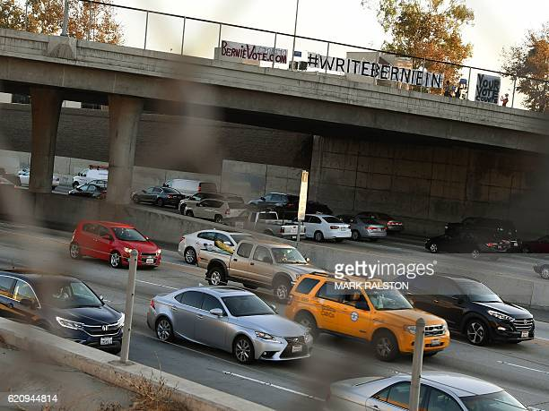 Supporters of Bernie Sanders display banners on the Palms Boulevard overpass of the San Diego Freeway alerting voters that Sanders is an official...