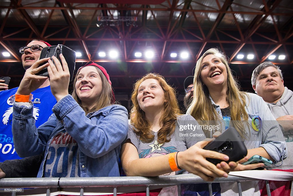 Supporters of Bernie Sanders watch as the democratic presidential candidate speaks at a rally on April 11, 2016 in Binghamton, New York.The New York Democratic primary is scheduled for April 19th.