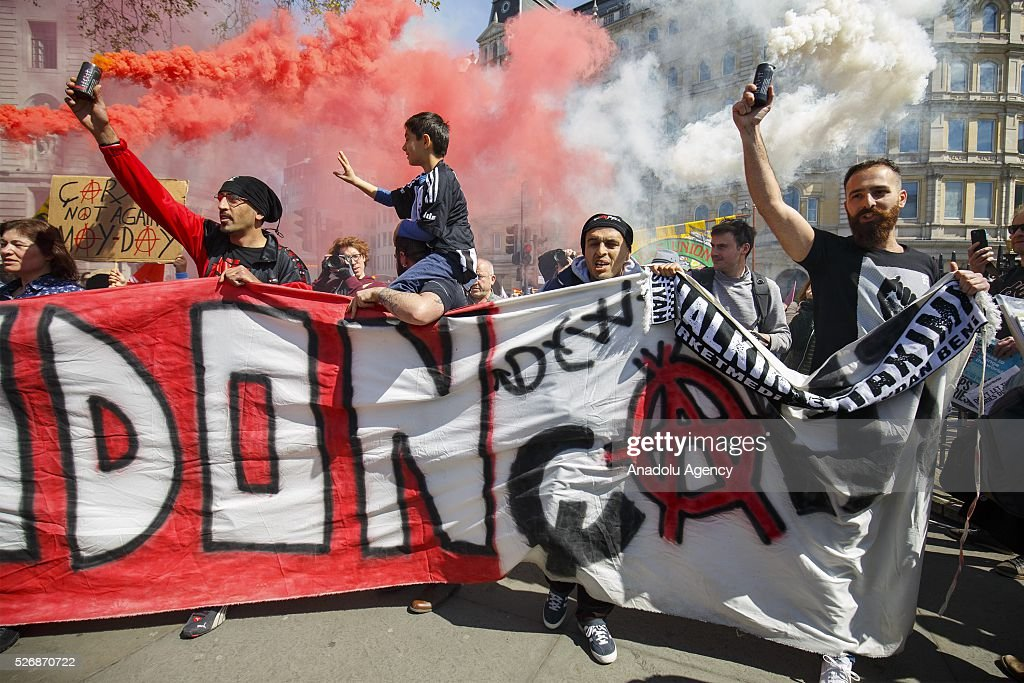 Supporters of Besiktas Football Club 'Carsi' hold flares at a May Day march in London, England to celebrate International Workers' Day on May 1, 2016.