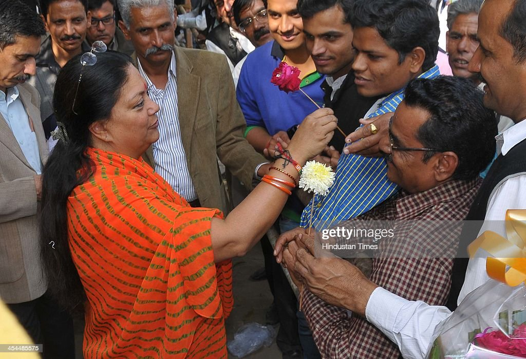 Supporters of Bharatiya Janta Party greet party Chief Ministerial candidate Vasundhara Raje at her residence to celebrate their party's win in...