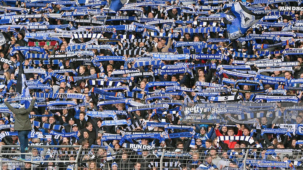 Supporters of Bielefeld cheer their team during the Third League match between Arminia Bielefeld and Energie Cottbus at Schueco Arena on April 4 2015...