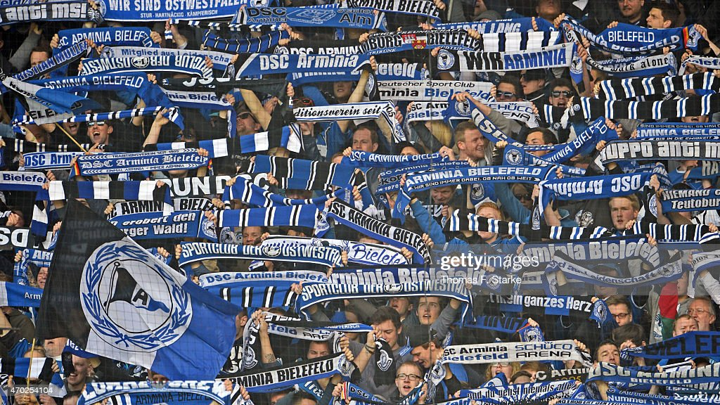 Supporters of Bielefeld cheer their team during the Third League match between Arminia Bielefeld and Preussen Muenster at Schueco Arena on April 18...