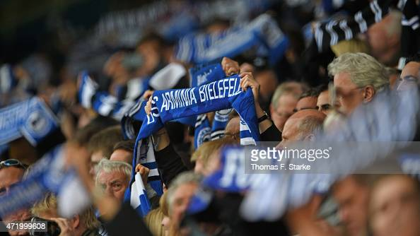 Supporters of Bielefeld cheer their team during the Third League match between Arminia Bielefeld and Holstein Kiel at Schueco Arena on May 2 2015 in...