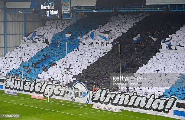 Supporters of Bielefeld cheer their team during the Third League match between Arminia Bielefeld and Jahn Regensburg at Schueco Arena on May 16 2015...