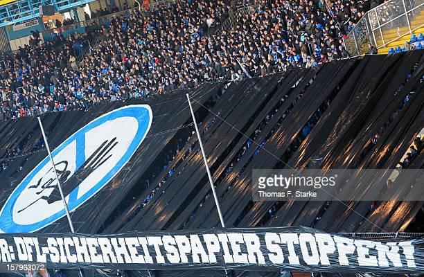 Supporters of Bielefeld show a banner 'DFL Sicherheitspapier stoppen' during the Third League match between Arminia Bielefeld and Borussia Dortmund...
