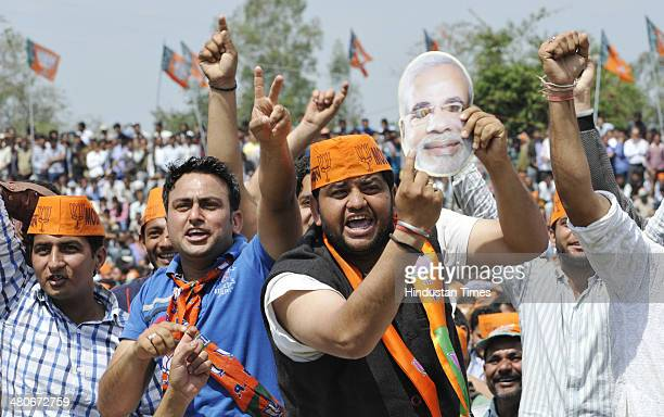 Supporters of BJP's prime ministerial candidate Narendra Modi during a public rally at Hira Nagar about 60 km from Jammu India on Wednesday MArch 26...