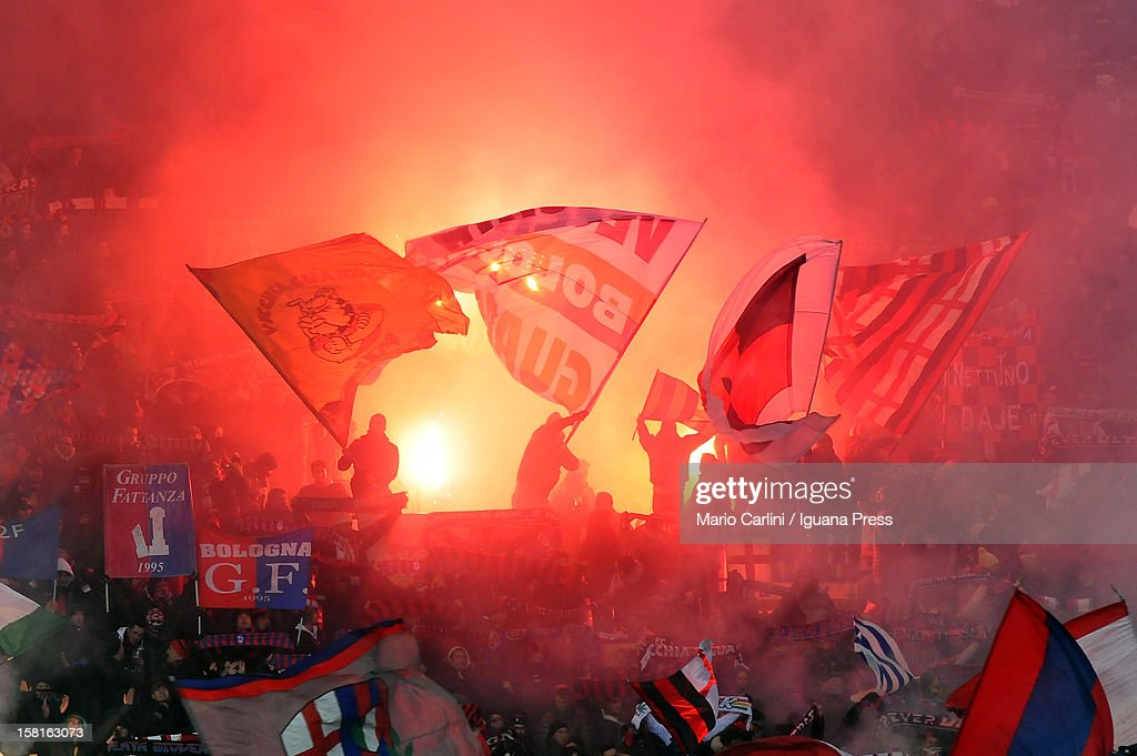 Supporters of Bologna FC let of flares and wave flags during the Serie A match between Bologna FC and S.S. Lazio at Stadio Renato Dall'Ara on December 10, 2012 in Bologna, Italy.