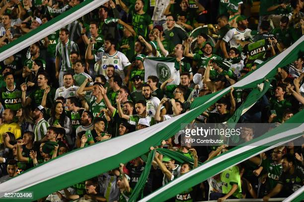 Supporters of Brazilian Chapecoense cheer for their team during their 2017 Copa Sudamericana football match against Argentina's Defensa y Justicia...