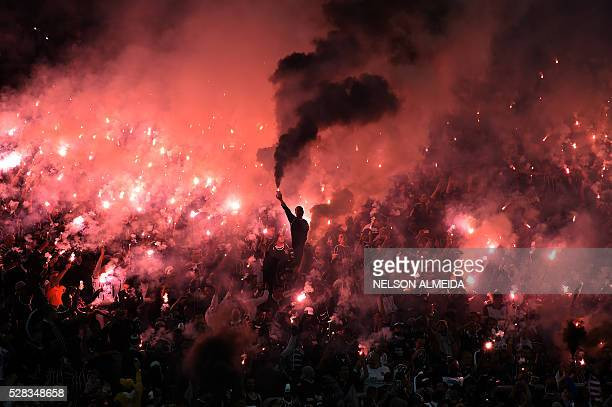 TOPSHOT Supporters of Brazilian Corinthians cheer for their team during the 2016 Copa Libertadores football match against Uruguay's Nacional held at...