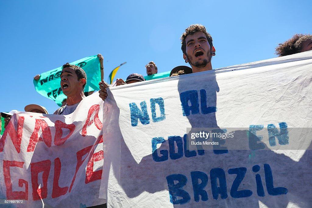 Supporters of Brazilian President Dilma Rousseff demonstrate against an impeachment trial against her, in front of Planalto Palace in Brasilia during Olympic Torch Arrives on May 3, 2016 in Brasilia, Brazil. The Olympic torch will pass through 329 cities from all states from the north to the south of Brazil, until arriving in Rio de Janeiro on August 5, to lit the cauldron.
