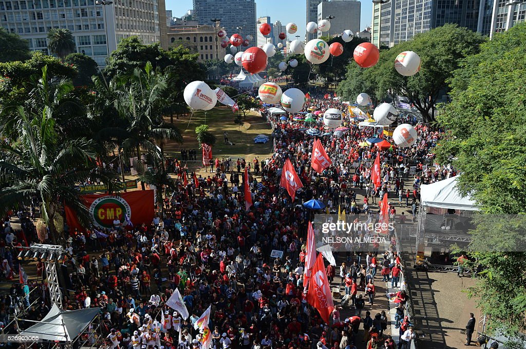 supporters of Brazilian President Dilma Rousseff take part in a demonstration to mark International Workers' Day, in Sao Paulo, Brazil, on May 1, 2016. / AFP / NELSON