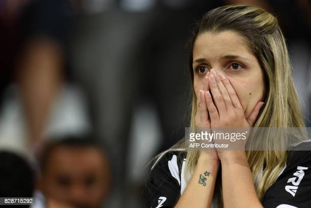 Supporters of Brazil's Atletico Mineiro react at the end of their 2017 Copa Libertadores match against Bolivia's Jorge Wilstermann held at Mineirao...